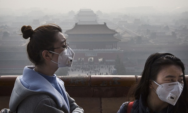 Chinese women wear masks as haze from smog caused by air pollution hangs over the Forbidden City in Beijing. Photograph: Kevin Frayer/Getty Images
