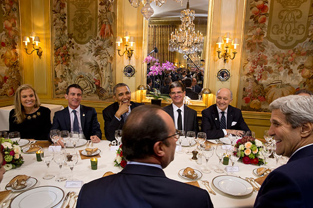 France's President Francois Hollande, bottom center, hosts a dinner at a Paris restaurant on the first day of the UN climate change conference, November 30, 2015. (Photo: Stephen Crowley / The New York Times)